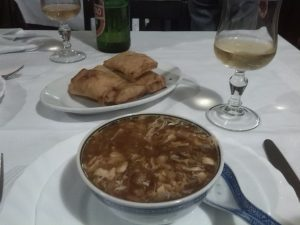 Hot and sour soup, spring rolls, Chinese food in Italy